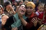<p>Uighur women grieve for their men they claim were taken away by Chinese authorities. Picture: AP</p>