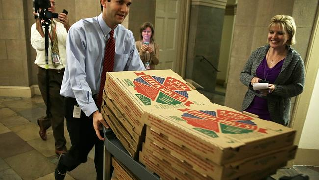These pizzas were seen entering negotiation rooms before a solution was reached. Picture: Alex Wong, Getty, AFP.