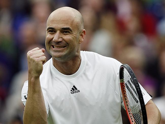 American star Andre Agassi celebrates while playing with Germany's Steffi Graf in a mixed