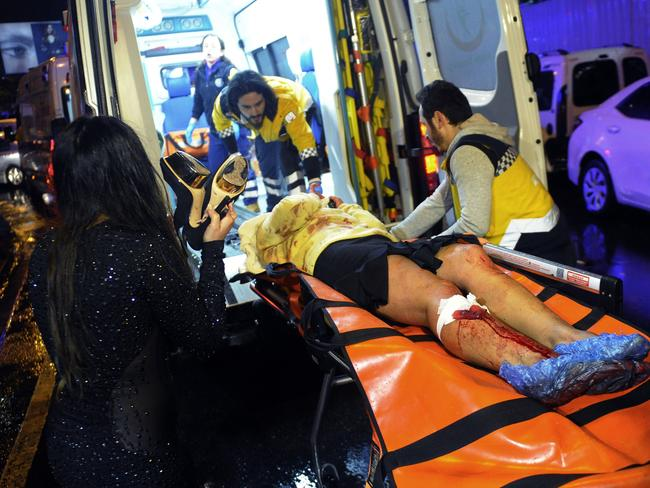 Medics carried a wounded person at the scene after the attack. Picture: IHA via AP
