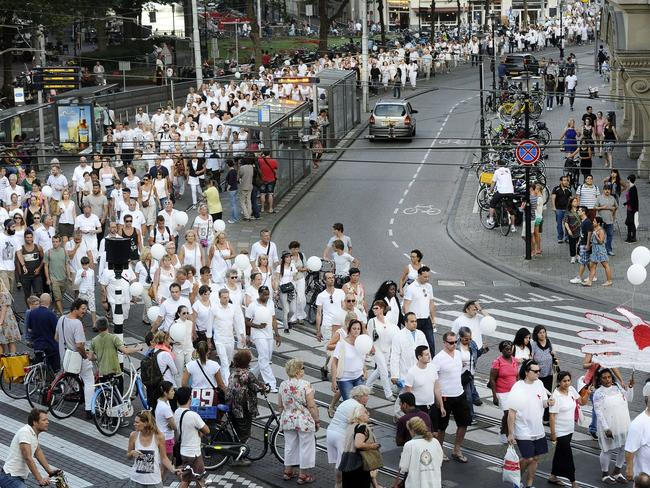 Memorial march ... People take part in a silent march in memory of the victims of the downed Malaysia Airlines flight MH17, on July 23, 2014 in Amsterdam.