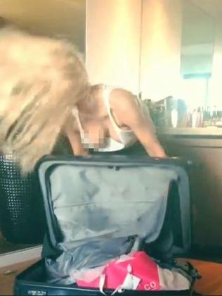 Open and shut case ... the 34-year-old writhes around her luggage. Picture: Instagram