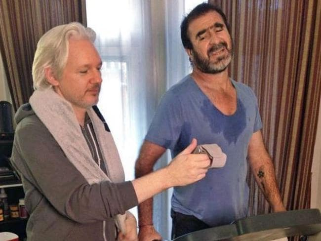 Sweating it ... Julian Assange and Eric Cartona working out together.