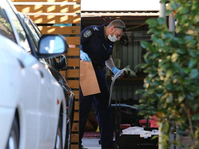 Crime-scene officers at the scene of the stabbing at Gilles Plains. Picture: Dylan Coker