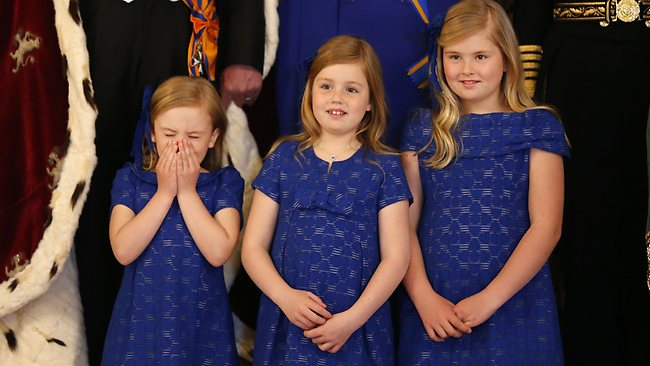 Dutch Crown Princesses Ariane, Alexia, and Catharina-Amalia take their place for a group photo inside the Royal Palace in Amsterdam, The Netherlands, Tuesday April 30, 2013. (AP Photo/Bart Maat, pool)
