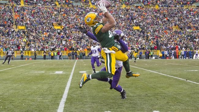 Jarrett Boykin #11 of the Green Bay Packers makes a catch against Chris Cook #20 of the Minnesota Vikings in overtime at Lambeau Field.