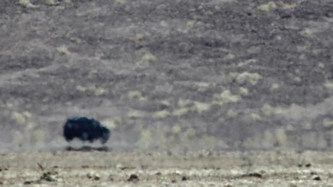A mirage makes a car appear as if it's flying as a heatwave spreads across the American West. Picture: Getty Images/AFP