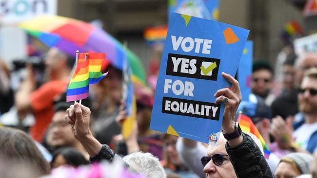 A new poll says 78 per cent of Australians believe same-sex and straight couples should be treated equally. Picture: James Ross/AAP Image