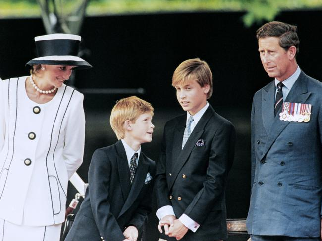 Andrew Morton was Diana's biographer, she is seen here with Princes Harry and William and then husband, Prince Charles. Picture: AFP