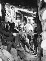 Gallipoli Peninsula, Turkey. 10 August 1915. Australian troops relax inside a captured Turkish trench at Lone Pine. The effect of our howitzer shells on the heavy head cover of pine logs, the breaking through of which in taking Lone Pine was the great difficulty, is shown. The officer with the wounded hand is Major (Maj) McConaghy, one of five officers of the 3rd Battalion who was not seriously wounded or killed in the attack. Back row, left to right: Driver Matthews, Field Artillery; Harry Harvey, C Company, 2nd Battalion AIF (killed at Bullecourt), (possibly Private (Pte) Thomas Oliver Gardner); 239 John Davis, C Company, 2nd Battalion AIF, peak hat; Frank Pierce, 2nd Battalion AIF. Front row, sitting: Maj McConaghy; Sergeant Matthews, 3rd Battalion AIF; Robert Whelan, 2nd Battalion AIF (killed at Bullecourt), (possibly Pte Alfred James Milton), wearing peak hat. PICTURE: Australian War Memorial