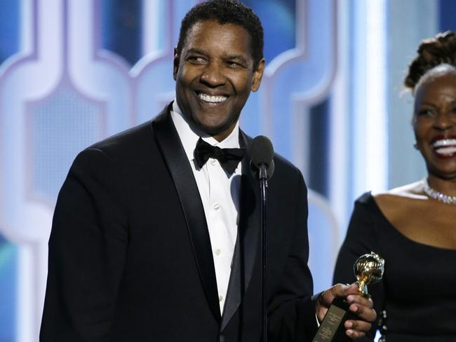 Washington accepts the Cecil B. DeMille Award. (Paul Drinkwater/NBC via AP)