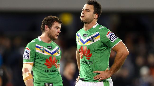 Dejected Raiders players Shaun Fensom and David Shillington after going down to the Tigers by one point.