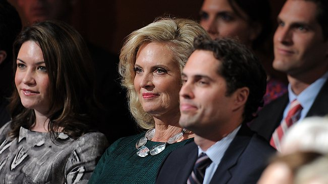 Tagg Romney with hismother Ann Romney (centre), wife of Republican presidential candidate Mitt Romney, and family members at he start of the third and final presidential debate.. Picture: AFP