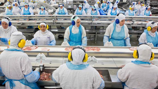 People work at a production line of the JBS-Friboi chicken processing plant during an inspection visit from government officials on March 21, 2017. Picture: Rodrigo Fonseca/AFP