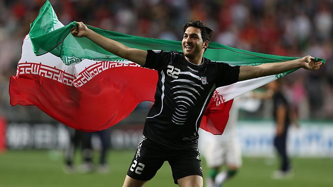 Iran's goalkeeper Alireza Haghighi celebrates after his team beat South Korea during the Asian zone Group A qualifying soccer match for the 2014 World Cup in Ulsan, South Korea.