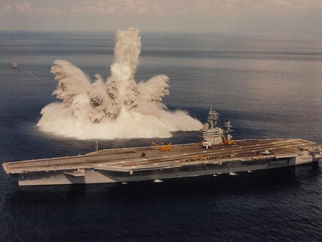Fallout ... The USS Theodore Roosevelt undergoing shock testing during sea trials in 1987. Source: USN