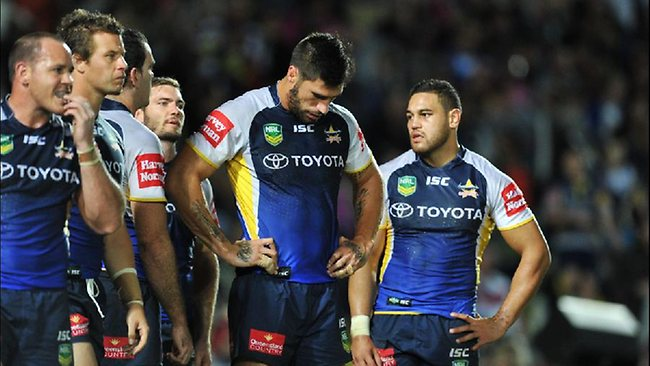 James Tamou (centre) and the Cowboys look dejected after the loss. Picture: Fiona Harding