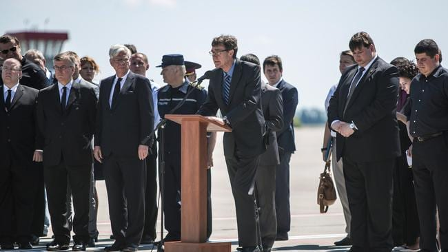 Australia's Special Envoy ... Angus Houston speaks at a departure ceremony for the victims of the crash of Malaysia Airlines flight MH17 to the Netherlands. Picture: Brendan Hoffman/Getty Images