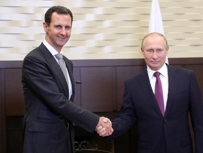Russia's President Vladimir Putin (R) shakes hands with his Syrian counterpart Bashar al-Assad. Picture: AFP.