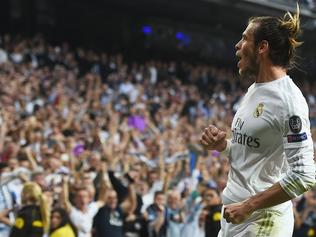 Real Madrid's Welsh forward Gareth Bale celebrates a goal during the UEFA Champions League semi-final second leg football match Real Madrid CF vs Manchester City FC at the Santiago Bernabeu stadium in Madrid, on May 4, 2016. / AFP PHOTO / PAUL ELLIS