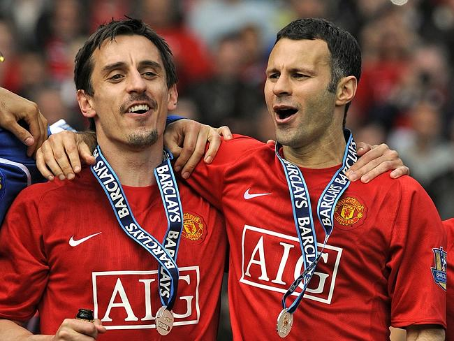 Gary Neville (L) and Welsh midfielder Ryan Giggs celebrate after they helped Manchester United clinch the EPL title in 2009.