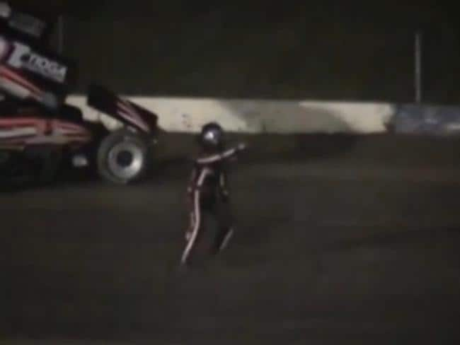 Kevin Ward Jr. points at Tony Stewart's car as it approaches.