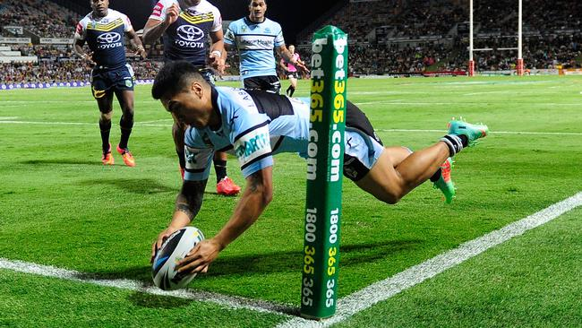 Sosaia Feki of the Sharks scores a try.
