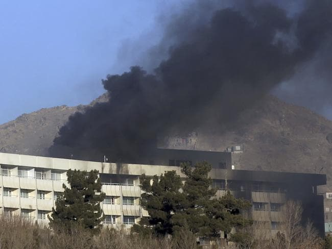 Black smoke rises from the Intercontinental Hotel. Picture: AP
