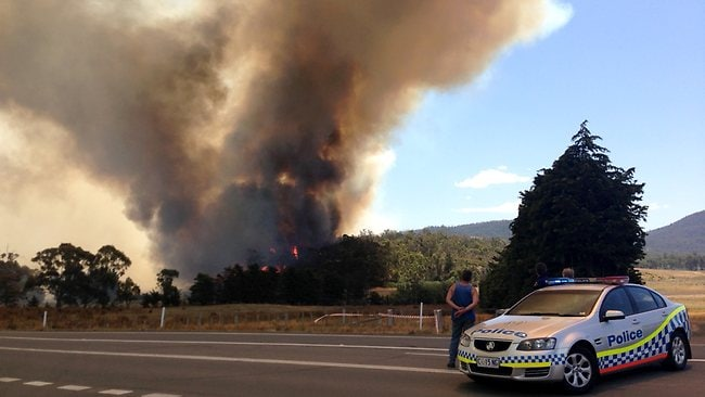 A bushfire rages out of control near Copping, in southern Tasmania, as temperatures in the state top 40C. Picture: Killick David