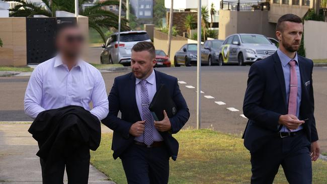 A man believed to be Mehajer (left) with a police officer on Tuesday morning. Picture: NSW Police Force.