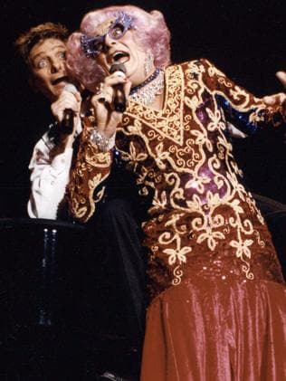 Comedian and actor, Barry Humphries, in character as Dame Edna Everage, joins Barry Manilow to perform on stage in Sydney in 1994. Picture: Supplied