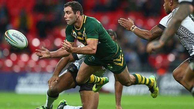 Cameron Smith offloads during the Rugby League World Cup Semi Final match against Fiji.