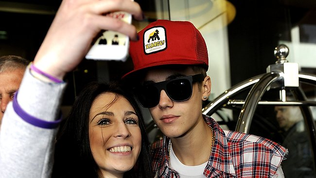A fan snaps a shot of herself with Justin Bieber at the Olsen Hotel in South Yarra. Picture: Jon Hargest