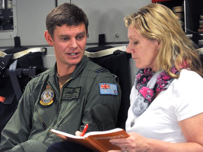 Emotional mission ... Flight Lieutenant Matt Eastaway speaking to journalist Jacquelin Magnay. Picture: Ben Stevens