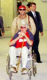 Ronnie Biggs is wheeled through the terminal at Rio de Janeiro's Galeao international airport in 2001.