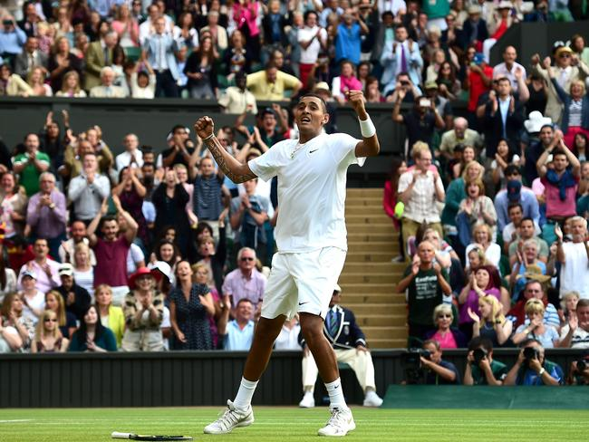 Nick Kyrgios celebrates victory over Rafael Nadal during their men's singles fourth round match.