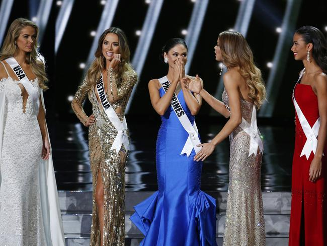 Tough choice ... the final five contestants on stage at the Miss Universe pageant. Picture: AP