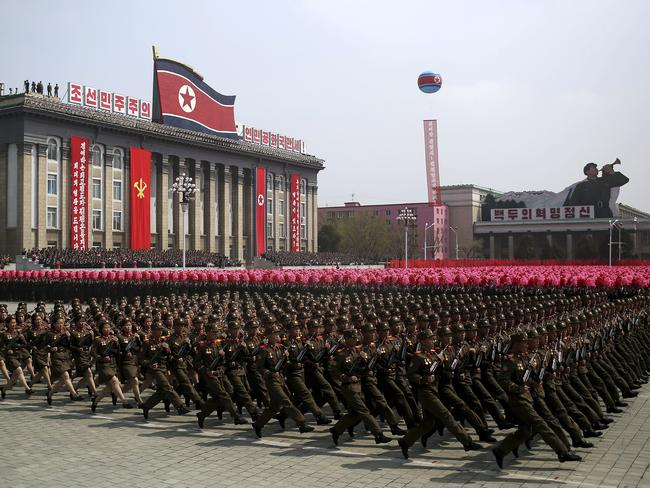 Soldiers march across Kim Il Sung Square during a military parade in Pyongyang, North Korea as tensions rise. Picture: AP
