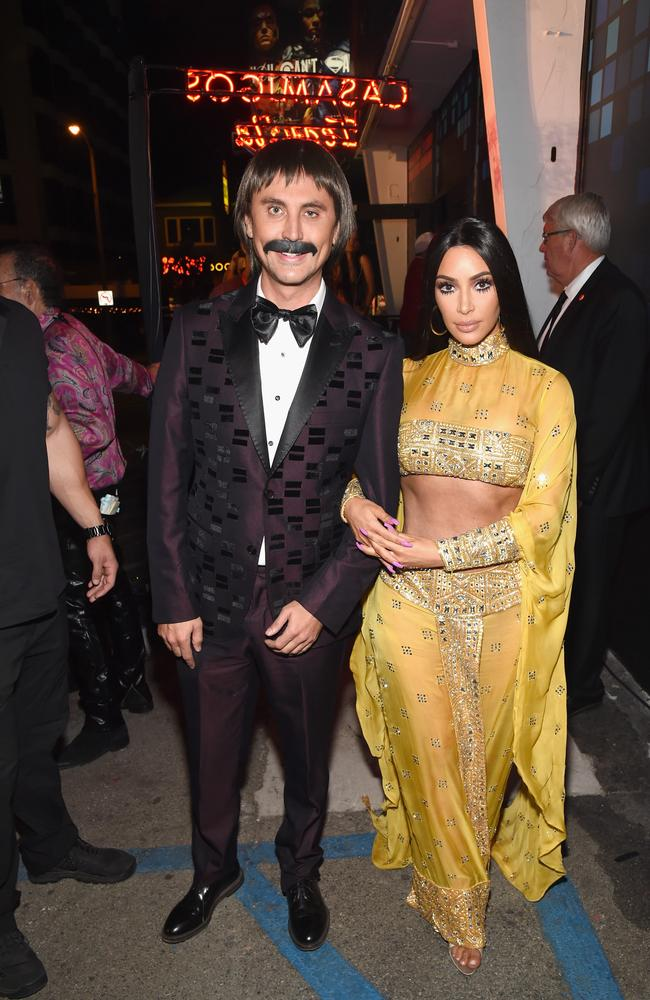 Jonathan Cheban and Kim Kardashian attend Casamigos Halloween Party as Sonny and Cher. Picture: Getty
