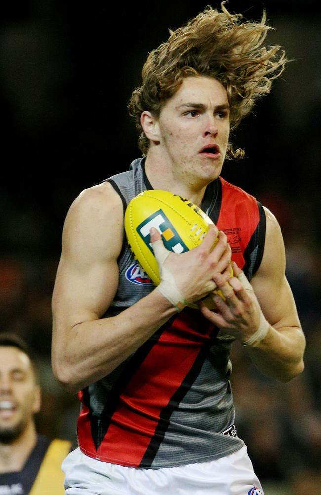 Daniher takes one of his four marks. Picture: Colleen Petch