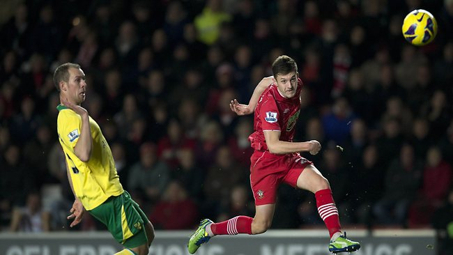 Southampton's Adam Lallana (R) shoots at goal as Norwich City's Scottish defender Steven Whittake closes in at St Mary's Stadium in Southampton. Picture: Adrian Dennis