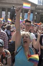 The crowd react to the same-sex marriage postal survey Yes result in front of the State library of Victoria in Melbourne, Wednesday, November 15, 2017. Picture: AAP Image/Luis Enrique Ascui