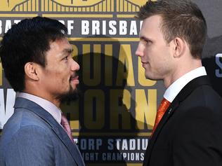 Manny Pacquiao of the Philippines (left) faces off with Australia's Jeff Horn following the official press conference for their WBO welterweight championship fight at Suncorp Stadium in Brisbane, Wednesday, June 28, 2017. (AAP Image/Dave Hunt) NO ARCHIVING