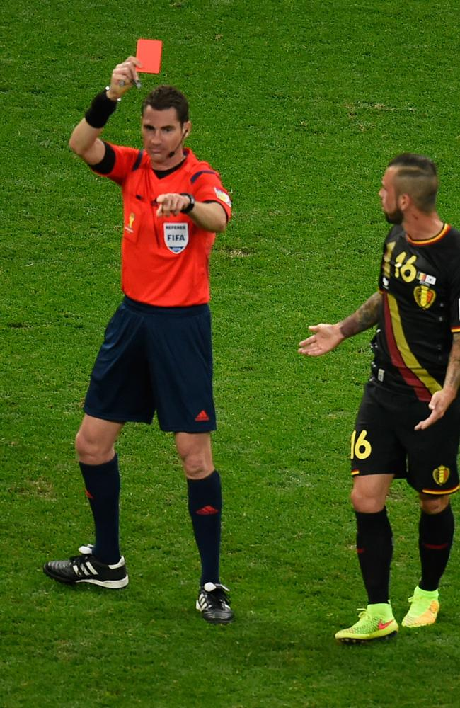 That's the Ben we know and, err, love? Belgium's midfielder Steven Defour (R) is shown a red card