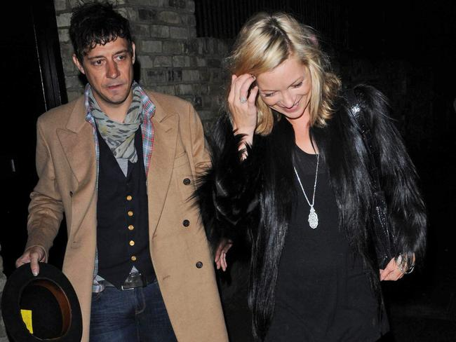 Married ... Model Kate Moss leaves her home with husband Jamie Hince.