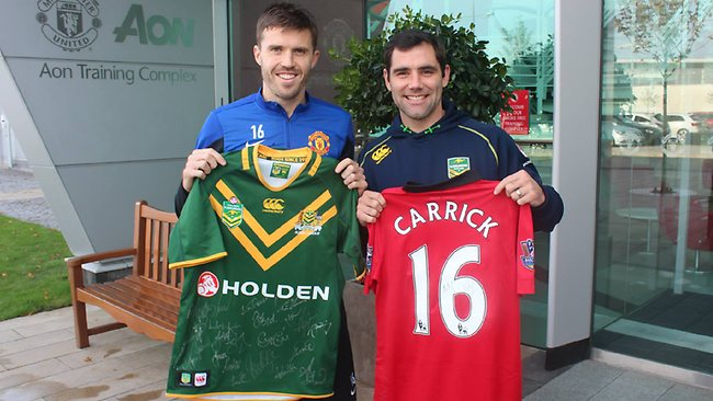 Kangaroos captain Cameron Smith swaps jerseys with Manchester United and England midfielder Michael Carrick. Picture: NRL
