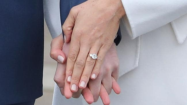 Prince Harry and Meghan Markle's hands clasped showing off the engagement ring. Picture: AFP PHOTO/Daniel LEAL-OLIVAS