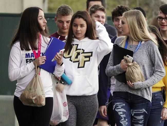 Marjory Stoneman Douglas High School students arrive back to school after spring break without backpacks. Picture: AP