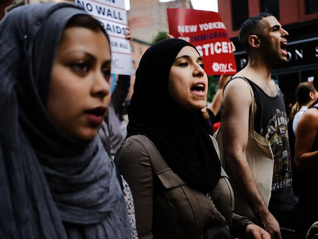 Recent immigrants join activists for an evening protest in Manhattan. Picture: Getty