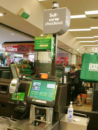 """Self-service checkouts (above) are preferred by younger shoppers who want to stay """"in the zone"""" rather than speak to supermarket staff. Picture: News Corp"""